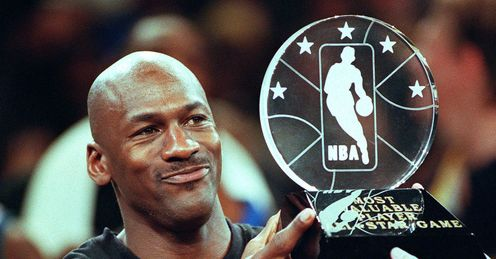 Beyond value: Jordan lifts the Most Valuable Player trophy in the NBA All-Star Game in 1998