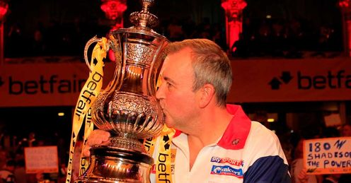 Taylor: seized the 2012 World Matchplay trophy in Blackpool