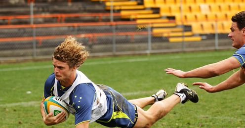Nick Cummins scoring a try in training