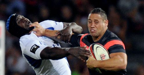 Toulouse s centre Luke McAllister R breaks away from Castres flanker Ibrahim Diarra 2012