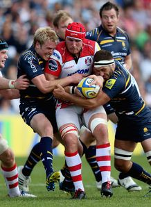 Gloucester eight Ben Morgan held by Worcester centre Joe Carlisle