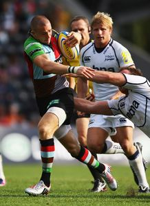 Mike Brown of Harlequins breaks through the Sale Sharks backs