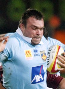 Perpignan s prop Nicolas Mas C is tackled