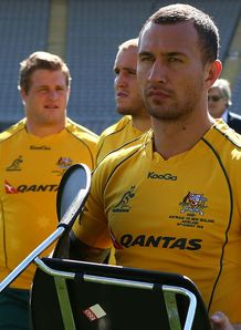 Quade Cooper with a chair