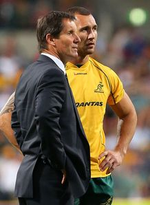 Robbie Deans and Quade Cooper looking on
