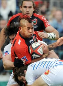 Toulon s David Smith C is tackled by Castres