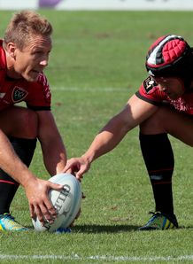 Toulon s Jonny Wilkinson assisted by teammate Matt Giteau