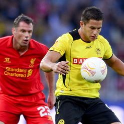 Jamie Carragher battles with Raul Bobadilla