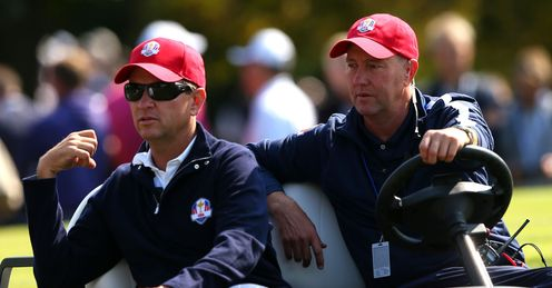 Davis Love III (L) watching anxiously as the US challenge crumbled on Sunday