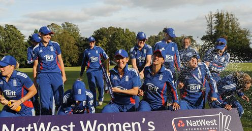 Champagne moment: England celebrate beating the West Indies