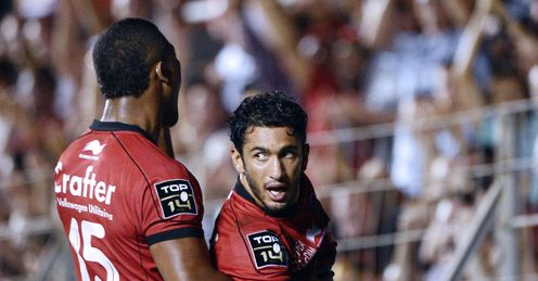 Toulon s Maxime Mermoz R reacts after scoring a try