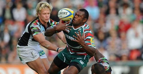Vereniki Goneva of Leicester Tigers is tackled by Matt Hopper L and Jordan Turner Hall R