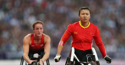 Wenju Liu of China crosses the line to win gold ahead of bronze medallist Tatyana Mcfadden of the United States