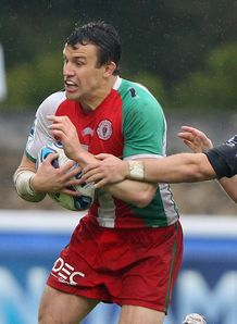 Damien Traille of Biarritz is tackled ACC