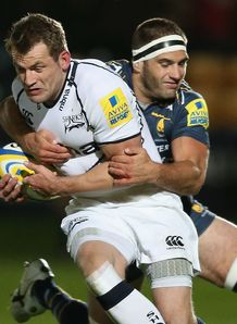 Mark Cueto of Sale is tackled by Worcester s Sam Betty