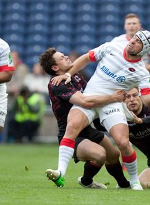 Saracens Schalk Brits is tackled by Edinburgh HEC