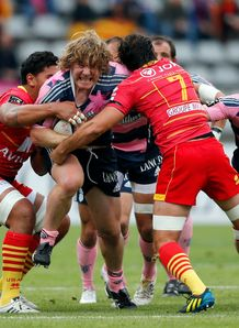 Stade Francais hooker Aled De Malmanche C is tackeld by Perpignan