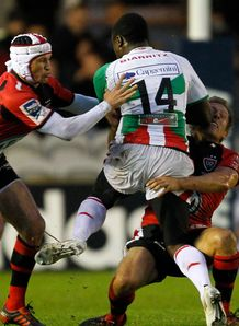 Taku Ngwenya of Biarritz C is tackled by Matt Giteau of Toulon L and Jonny Wilkinson of Toulon