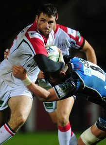 Ulster fullback Jared Payne l breaks the tackle of Glasgow number 8 Ryan Wilson