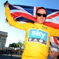 Historic moment: Wiggins celebrates becoming the first British rider to win the Tour de France