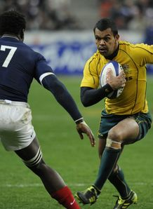 Australian fullback Kurtley Beale R vies with French flanker Fulgence Ouedraogo