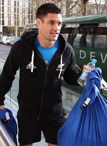 Dan Carter carrying bags
