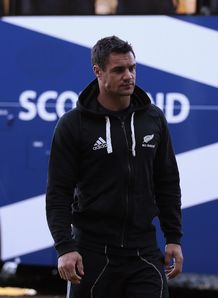 Dan Carter in front of bus