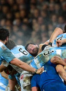 France s prop Yannick Forestier C vies with Argentina s players