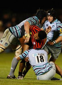 Nathan Earle of Saracens is tackled LV Cup v Leicester Tigers