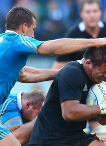 New Zealand Keven Mealamu R is tackled by Italy s centre Alberto Sgarbi