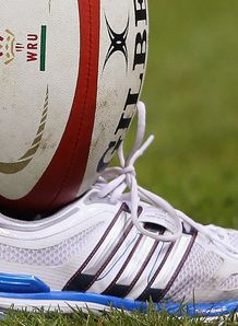 Rugby ball in trainer