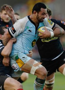 Samu Manoa of Northampton charges through the Newport defence