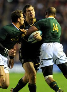 Scotland wing Tim Visser being held