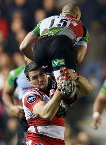 Shane Monahan of Gloucester makes an illegal tackle on Mike Brown of Quins