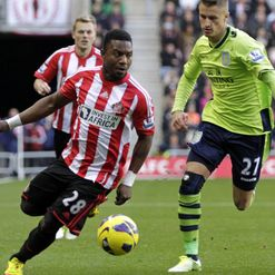 Stephane Sessegnon and Joe Bennett