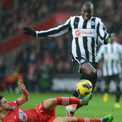 Adam Lallana tackles Demba Ba