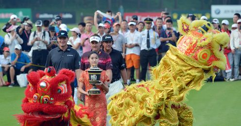 A very Chinese reception for Ian Poulter, Ernie Els and Phil Mickelson
