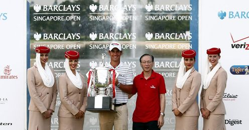 A proud Manassero poses with the Barclays Singapore Open trophy