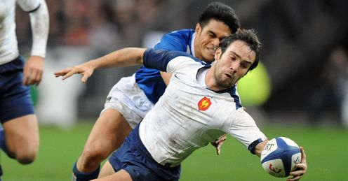France s scrum half Morgan Parra C vies with Samoan s winger David Lemi rear