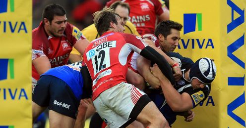 Gavin Henson and Seb Jewell of London Welsh hold up Dave Attwood of Bath