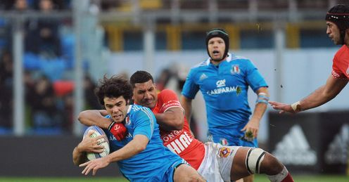 Luke Mclean of Italy is tackled by Siviteni Mafi of Tonga