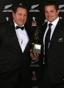 All Black coach Steve Hansen L and captain Richie McCaw pose with the Team of the Year award