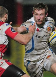 Matt Jess of Exeter is tackled by Charlie Sharples of Gloucester