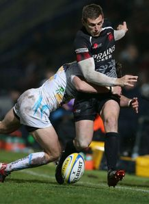 Nick Scott of London Welsh is tackled by Alex Grove