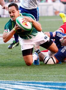 Paul Delport of South Africa scores a try sevens
