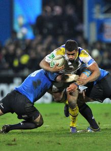 clermont centre Wesley Fofana C is tackled by two Leinster players