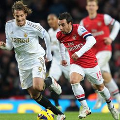 Michu and Santi Cazorla in flight