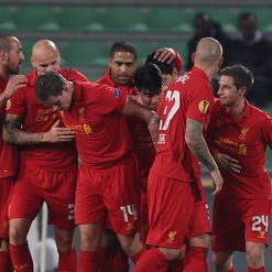 Jordon Henderson celebrates his goal with his Liverpool team-mates.