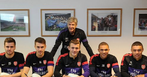Signed: Jenkinson, Ramsey, Wilshere, Gibbs and Oxlade-Chamberlain put pen to paper