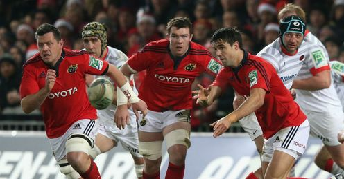 Conor Murray of Munster passes the ball